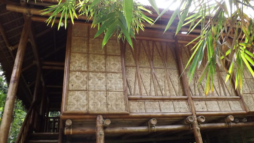 side of bamboo house highlighting removable windows